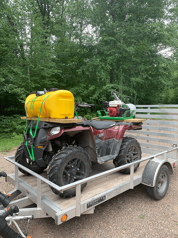 lawn care equipment in a trailer