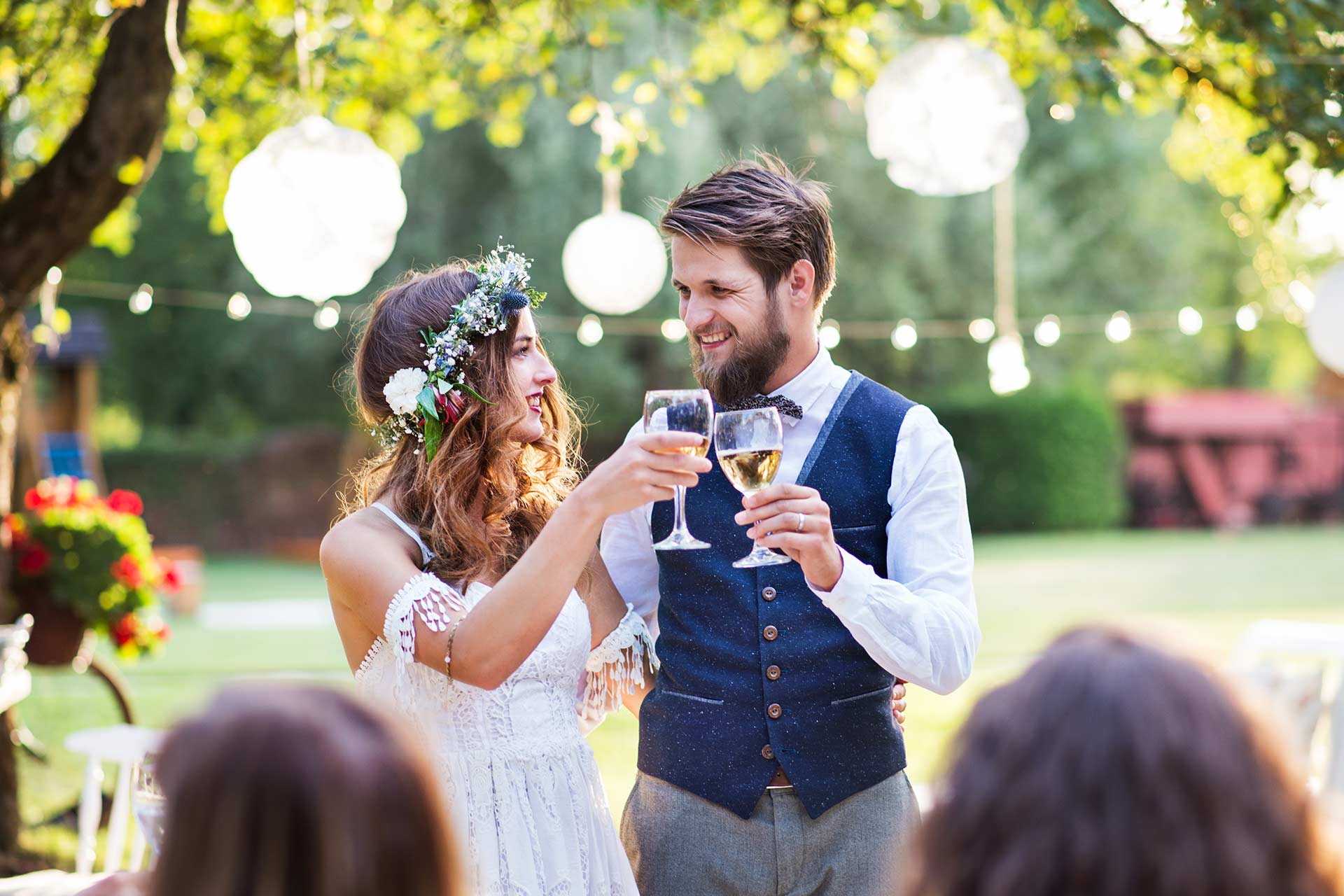 a couple toasting at their outdoor wedding