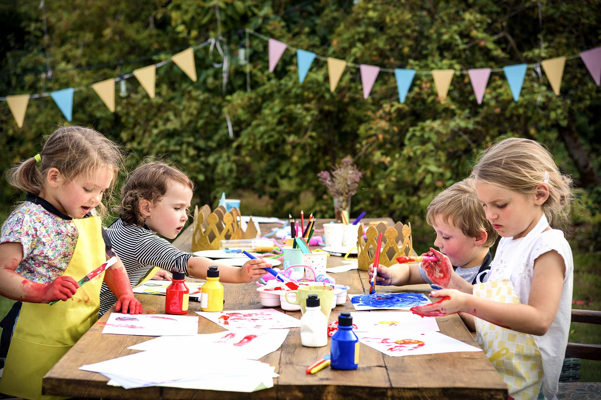kids painting outdoors at a party